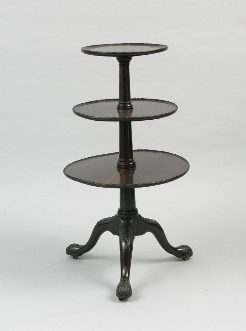 An Antique Three Tiered Dumbwaiter Table