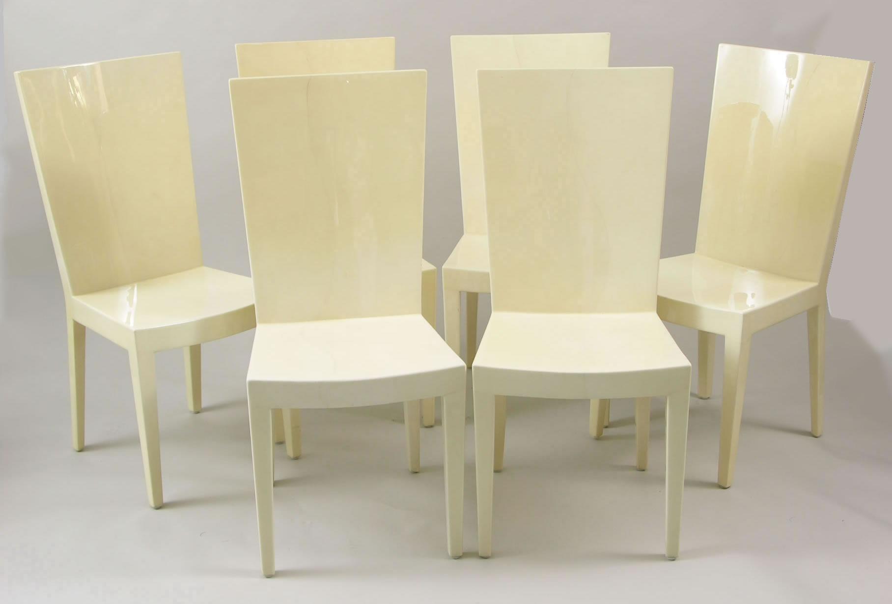 A Set Of Parchment Lacquered Dining Chairs In The Style Karl Springer