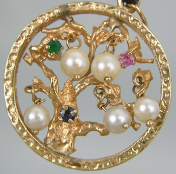 a quot cedar tree quot pendant in gold with gemstones and pearls