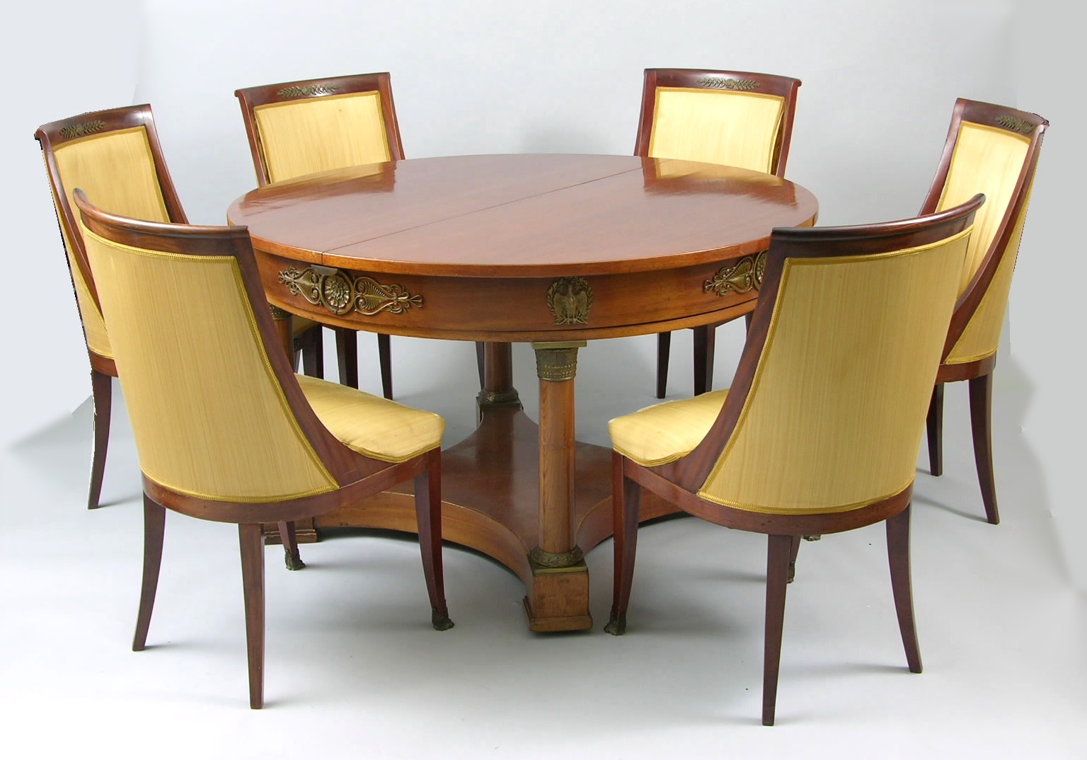 An Empire Style Dining Table And Six Chairs Ca 19th Century