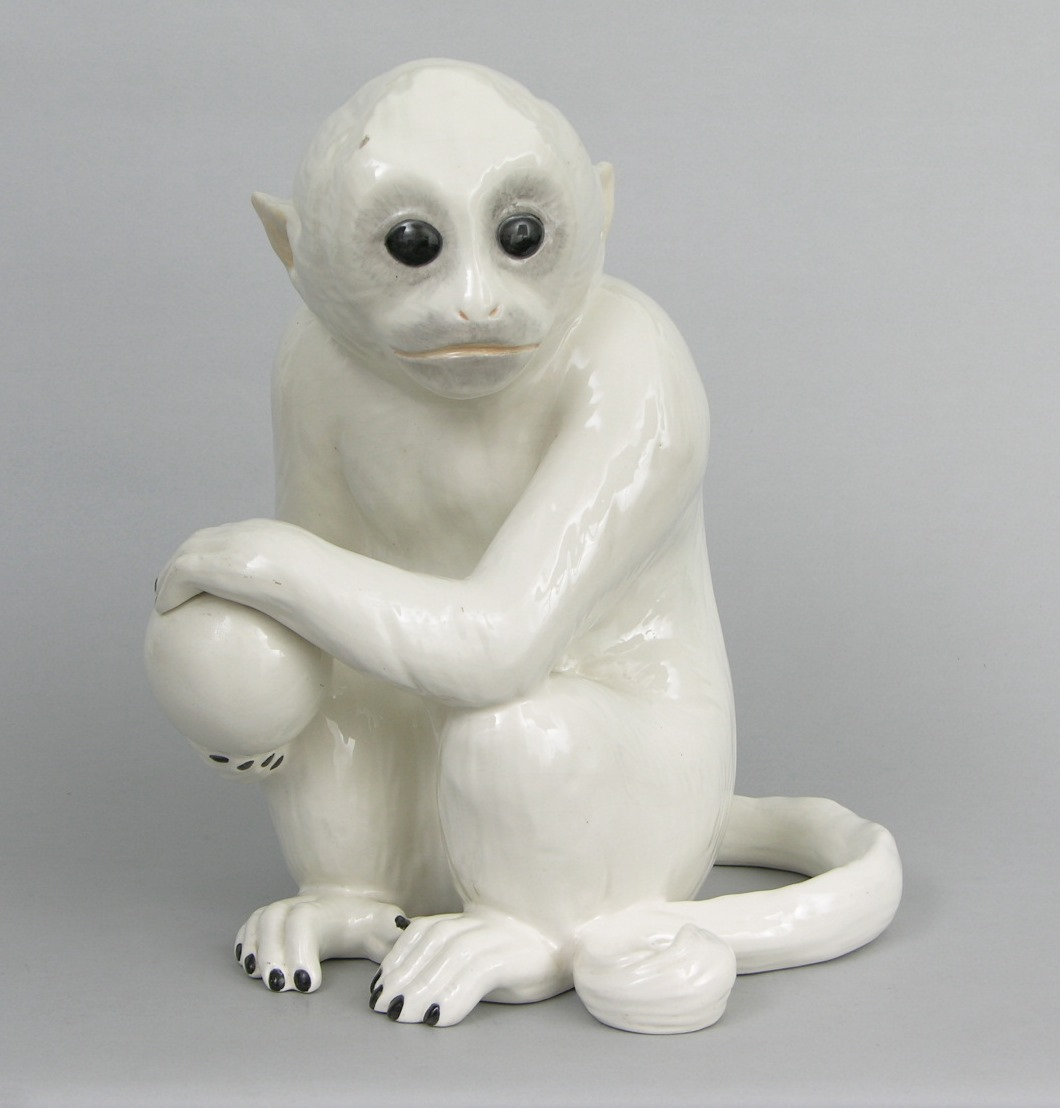 A Large Glazed Ceramic Monkey Holding A Ball 05 14 09