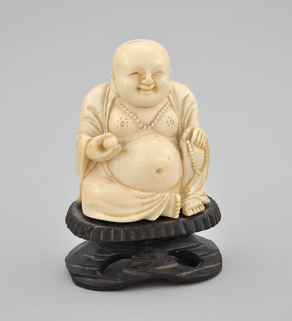 Orientalia november 2009 auction a carved ivory figure of seated buddha mozeypictures Images