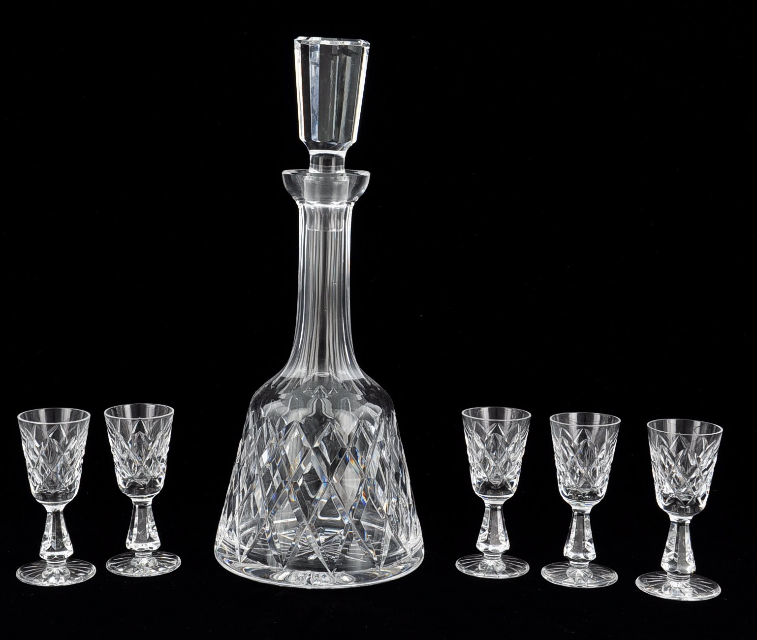 A Waterford Crystal Decanter With Stopper And Five Cordial
