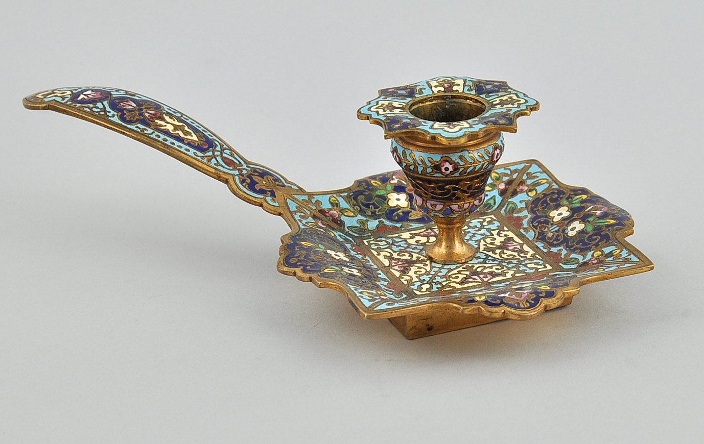 A french champleve enamel and ormolu bronze chamber stick for French chamber