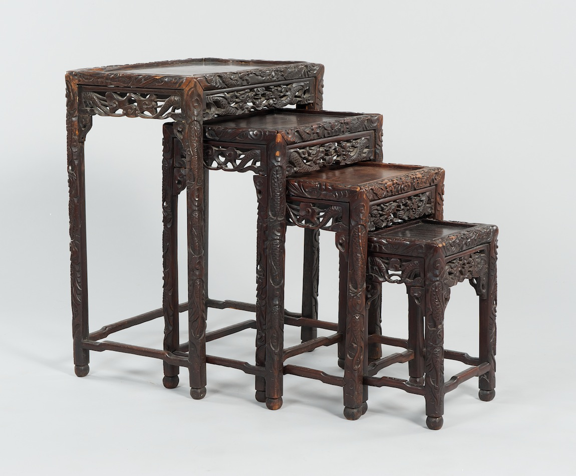 A set of four carved wood chinese nesting tables