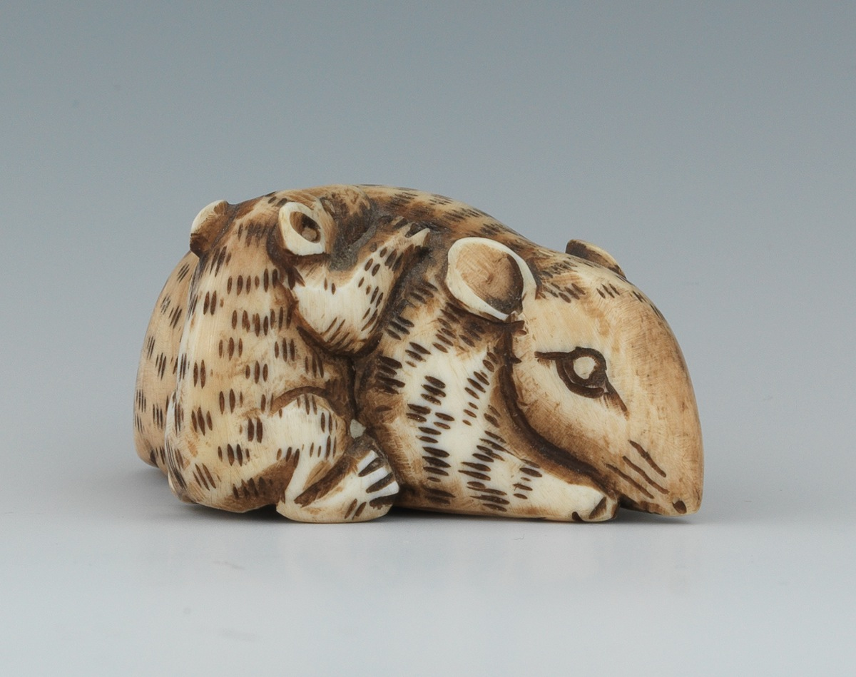 A Carved Ivory Or Bone Netsuke Of Two Mice 09 03 11 Sold 63 25