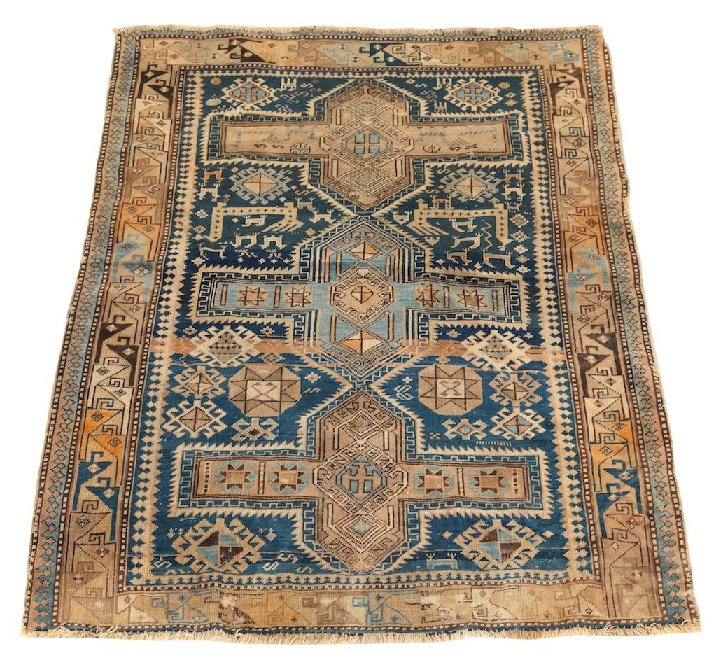 An Antique Caucasian Rug, 05.26.12, Sold: $546.25