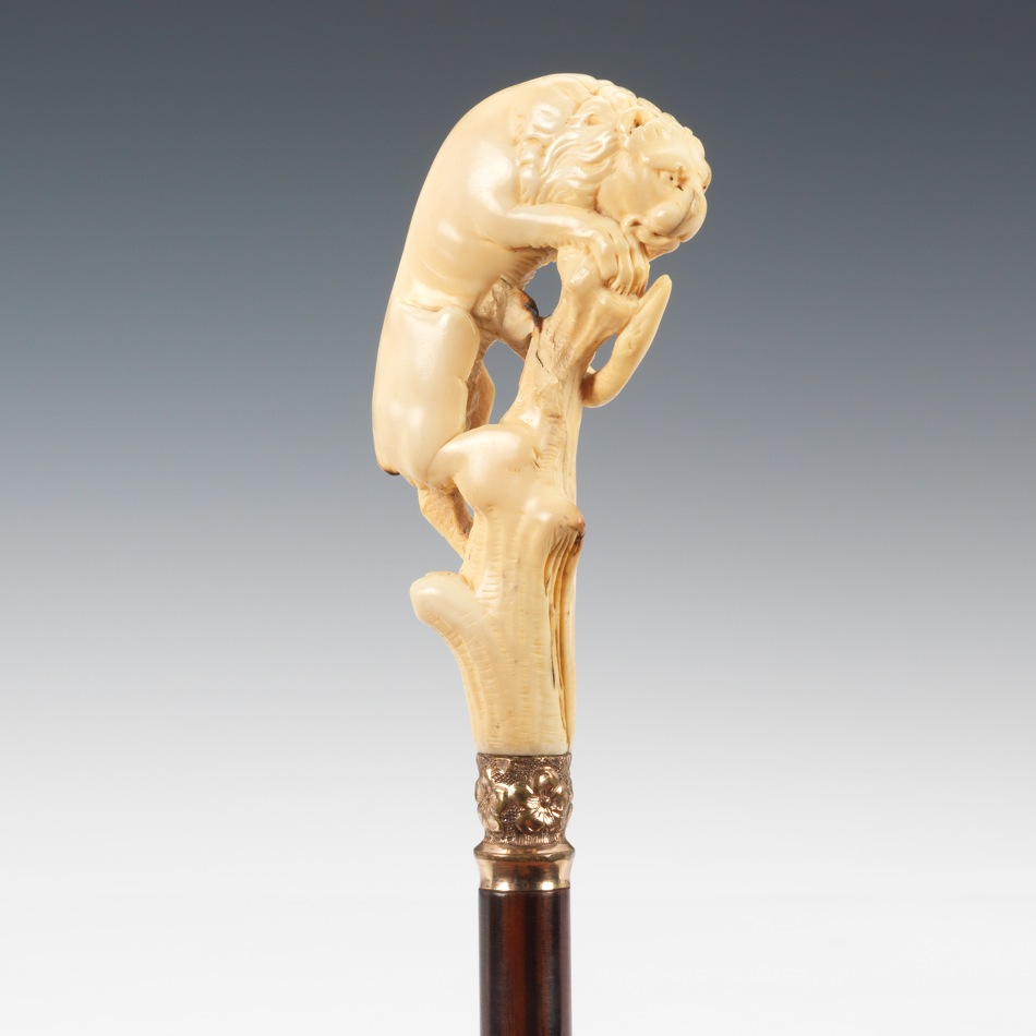 A Parasol With Carved Ivory Lion And Serpent Handle 11 09