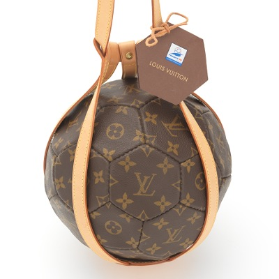 ff2353c86ce4 A Louis Vuitton Soccer Ball in Leather Holder