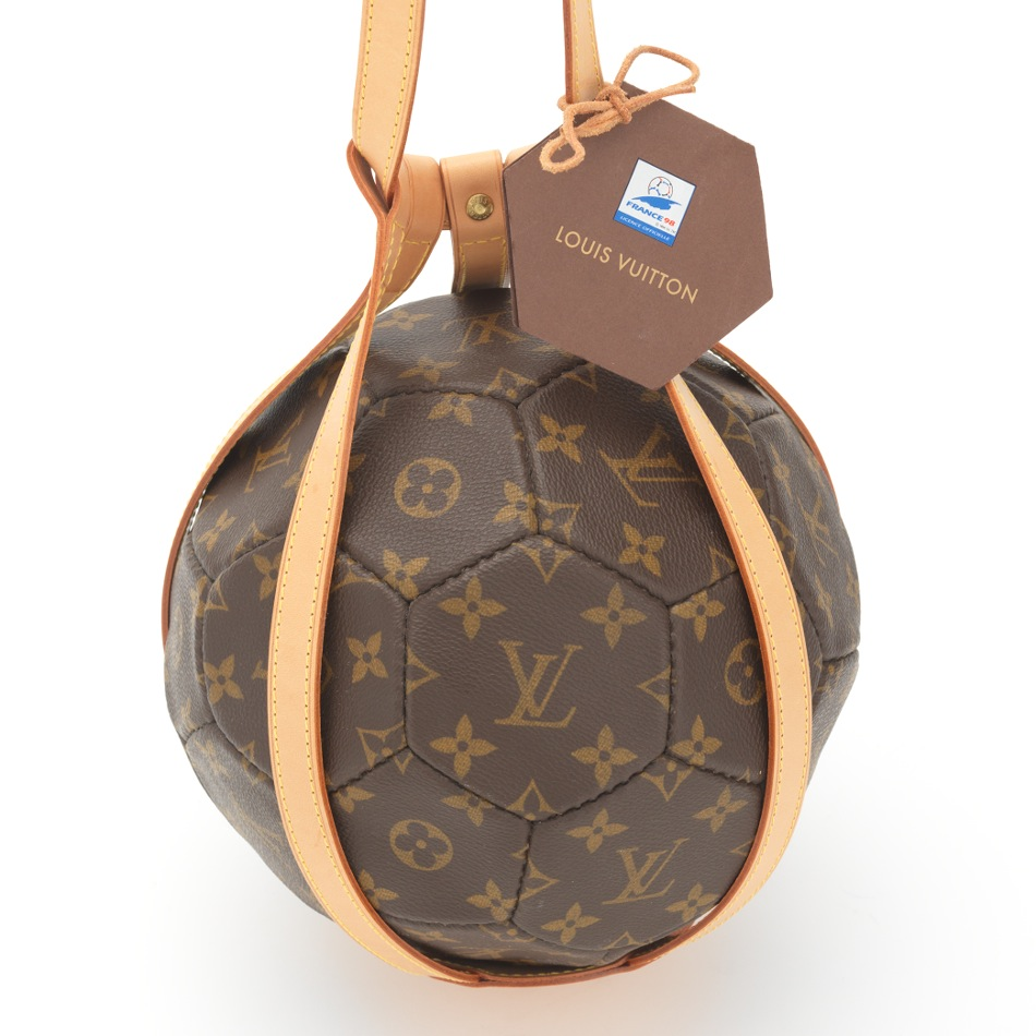 59d3bde20620 A Louis Vuitton Soccer Ball in Leather Holder, 09.21.13, Sold: $603.75