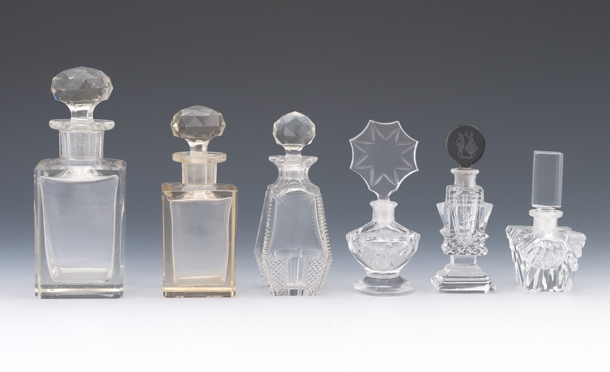 Six decorative clear glass perfume bottles sold for Decorative vials