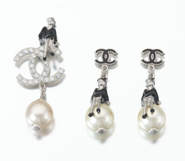 Chanel Costume Jewelry Set Of Earrings And A Pin With Coco On The Moon
