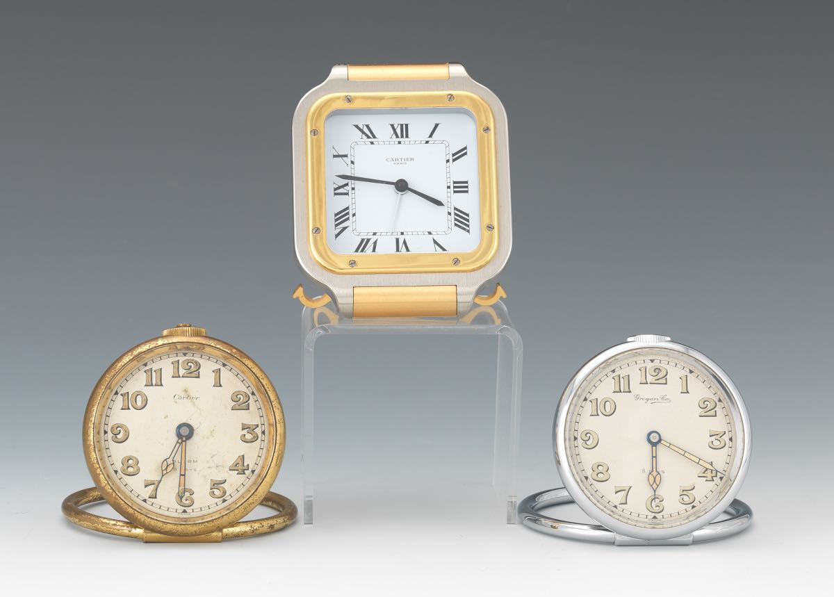 Group Of Three Desk Clocks Including Two Cartier And One Grogan